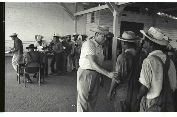 Inspection of Braceros - Braceros being inspected as they enter the United States, 1956